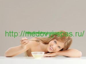 beauty portrait of woman with honey, smiling